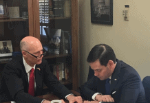 Rick-Scott-with-Marco-Rubio-reviewing-document-525x420