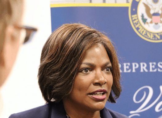val demings next to house seal sign.png