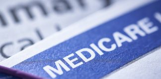 closeup of a Medicare health insurance card with a paperclip