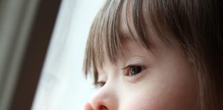 young girl_down syndrome_canstockphoto15102437 525x420